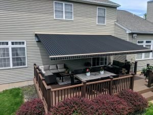 Furnished deck with large black awning