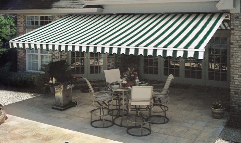 Patio with blue striped awning
