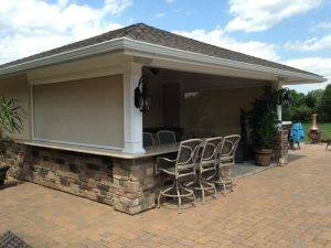 Enclosed outdoor bar and chairs with Sentry patio screen