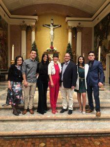 family celebrating christmas at church